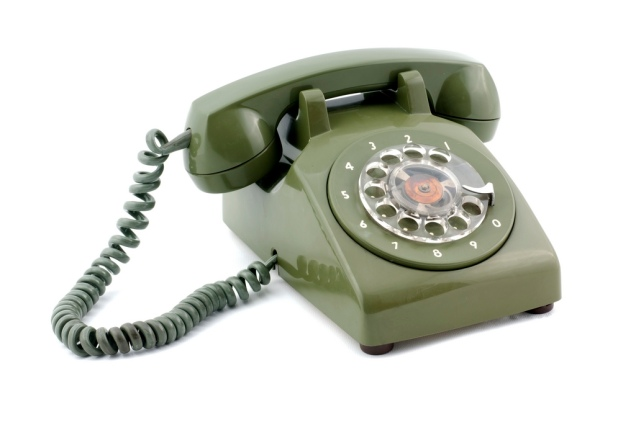 Old fashioned green telephone