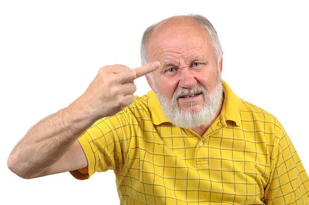 senior bald man shows middle finger