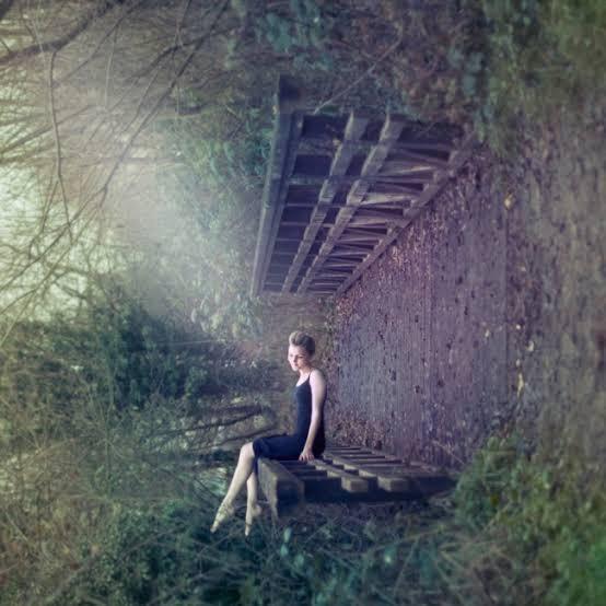 Side sitting on a bridge
