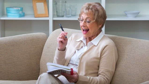 Mature Woman with Book and Pen